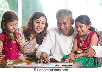 Indian family playing carrom game - Happy Asian Indian...