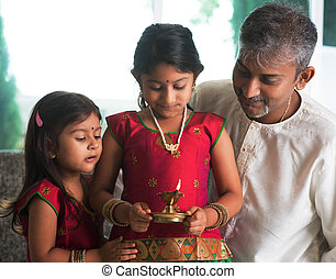 Celebrate diwali or deepavali at home - Indian family in...