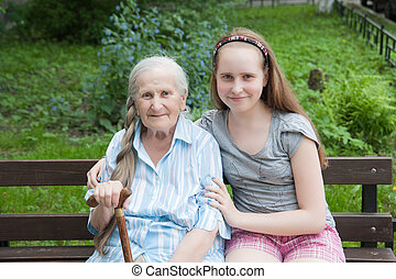 Grandmother with her grandaughter smiling - Granddaughter...
