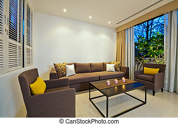 Bright Living room with grey sofa armchair combination
