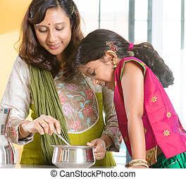 Indian family cooking at home - Asian family cooking food...