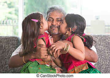 We love you daddy. - Happy Indian family at home. Two cute...