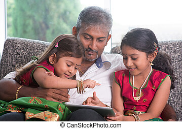 Indian family using tablet computer.