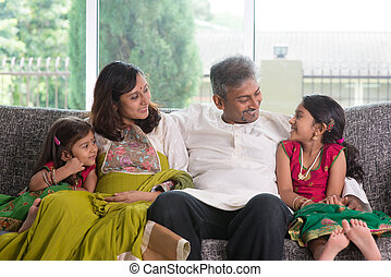 Family talk - Happy Indian family at home. Asian parents...