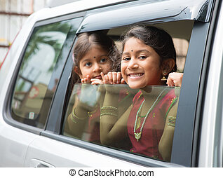 Family trip - Asian Indian family going to a vacation Happy...