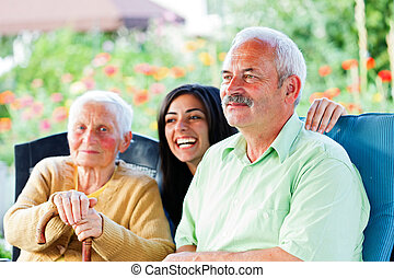 Happy Times in the Nursing Home - Smiling old man visiting...