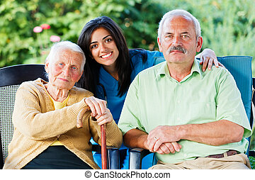 Doctor and Seniors - Young nurse or doctor with an elderly...