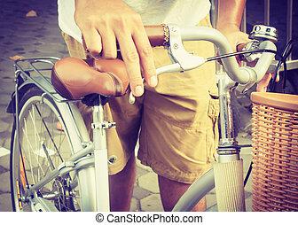 handlebar - Hand holding bicycle handlebar