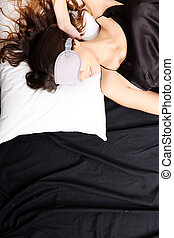 Young woman sleeping with Eyeshades - A young woman sleeping...