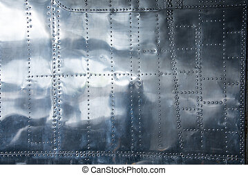 Aluminium background. This is a part of a side panel of a...