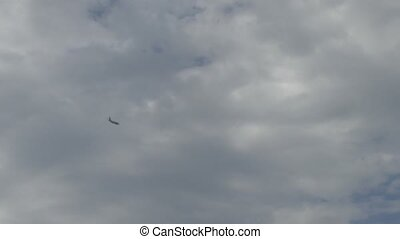 Passenger airplane in the clouds - Passenger airplane for...