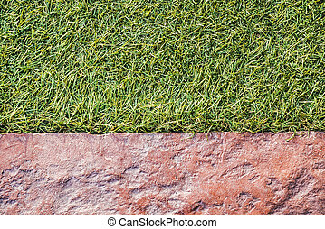 Artificial grass and stone floor