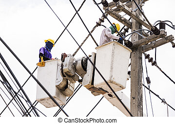 Electrician worker in a bucket, Electrical repairs to normal...