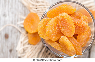 Fried Apricots close-up studio shot on vintage weathered...