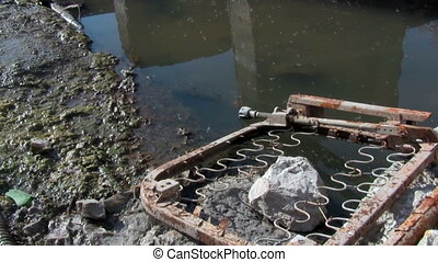 Dirty abandoned place with polluted water