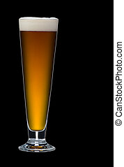 Beer - A close up of a single glass of beer on a black...