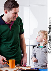 Man and child prepare a meal