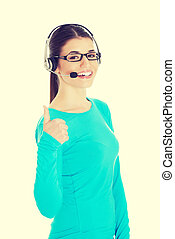 Woman with headphones and microphone showing ok.
