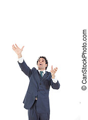 business man reaching to grab something from above his head,...