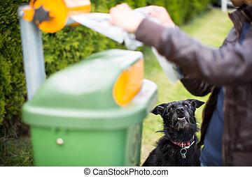Do not let your dog faul! - Young woman grabbing a plastic...