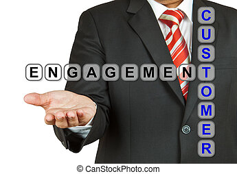 Businessman with wording Customer Engagement isolated on...