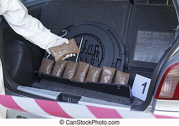 drug trafficking - drug bundles smuggled in a car trunk...