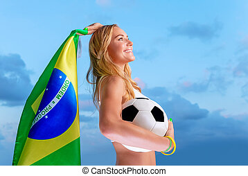 Happy fan of Brazilian football team, cheerful pretty girl...