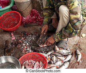 Selling fish at traditional asian seafood marketplace in...