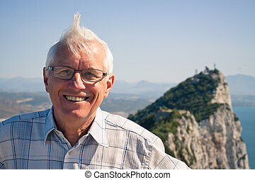 Senior man tourist at the Rock of Gibraltar - Portrait of...
