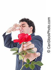man in suit throws a rose and gives it to the camera with...