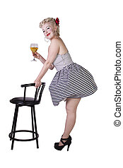 Beautiful pinup retro girl with wine enjoying cool air from fan