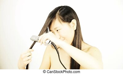 Funny asian girl play with hair - Straightening long hair