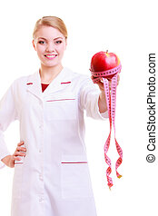 Woman doctor dietitian in lab coat recommending healthy...