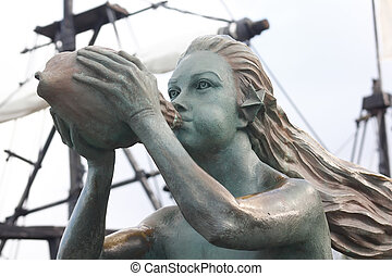siren as figurehead of an old sailboat