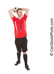 Referee Throwing Soccer Ball Over While Background