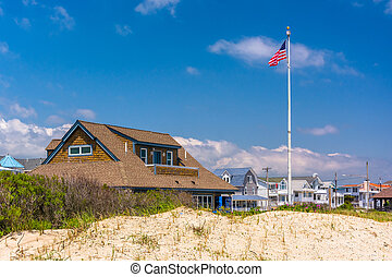 Sand dunes and houses in Ocean City, New Jersey. - Sand...