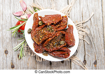 Sun dried Tomatoes - Portion of sun dried Tomatoes with...