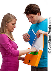 Putting notebook to paper file - Girl putting notebook to...