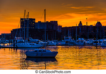 Sunset over a marina in Baltimore, Maryland.
