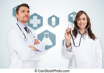 Composite image of happy medical team against blue medical...
