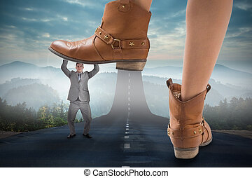 Composite image of cowboy boots stepping on businessman...