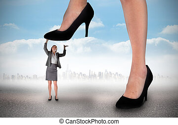 Composite image of businesswoman stepping on tiny...