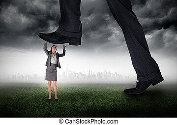 Composite image of businessman stepping on tiny...