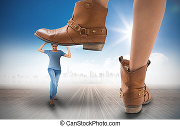 Composite image of cowboy boots stepping on girl against...