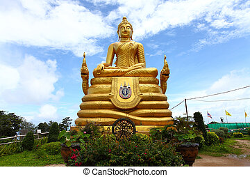 The gold statue of Big Buddha over blue sky