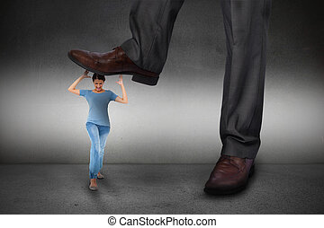 Composite image of businessman stepping on girl on grey...