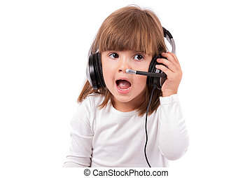 Little girl listening to music