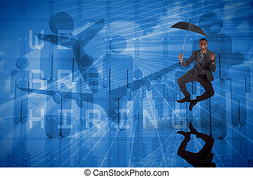 Composite image of businessman cheering and holding umbrella...