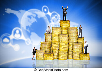Composite image of business people on pile of coins against...