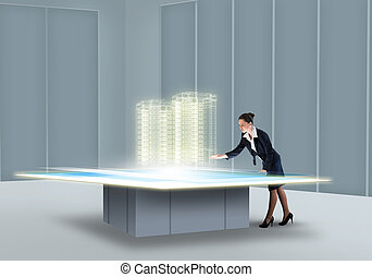 Innovative technologies - Businesswoman looking at hologram...